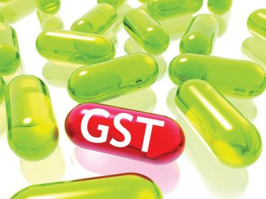 gst 373x280 - Drug Industry under Scanner,did they pass benefits of reduced tax to consumers?